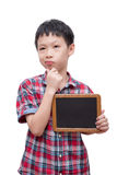 Boy holding chalkboard over white Royalty Free Stock Images