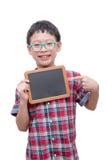 Boy holding chalkboard over white Stock Photo
