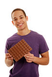 Boy holding chocolate bar Stock Photo