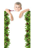 Boy  holding a christmas banner Stock Images