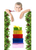 Boy  holding a christmas banner Royalty Free Stock Image