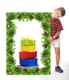 Boy  holding a christmas banner Royalty Free Stock Images