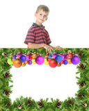 Boy  holding a christmas banner Royalty Free Stock Photography