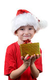 Boy holding a christmas gift Royalty Free Stock Image