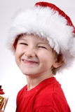 Boy holding a christmas gift Stock Photos