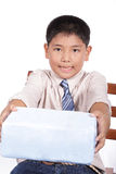 Boy holding Christmas gift Stock Images