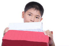 Boy holding Christmas gift Royalty Free Stock Photography