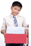Boy holding Christmas gift Stock Photo