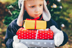 Boy holding Christmas gifts Stock Photos
