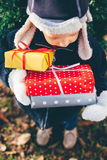 Boy holding Christmas gifts Stock Photo