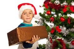 Boy holding Christmas present Royalty Free Stock Photos