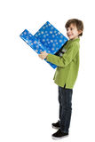 Boy holding Christmas presents Stock Image