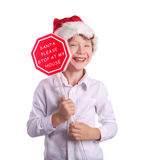 Boy holding christmas sign asking Santa to come by Royalty Free Stock Photo