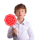 Boy holding christmas sign asking Santa to come by Royalty Free Stock Images