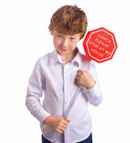 Boy holding christmas sign asking Santa to come by Royalty Free Stock Photography