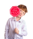 Boy holding christmas sign asking Santa to come by Royalty Free Stock Photos