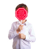 Boy holding christmas sign asking Santa to come by Stock Images