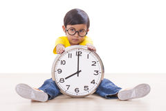 Boy  holding clock Royalty Free Stock Photo