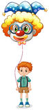 A boy holding a clown balloon with an eyeglass Stock Photo