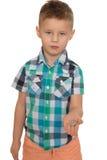 Boy holding a coin Stock Photo