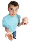 Boy Holding Coins For Money Box Royalty Free Stock Photos