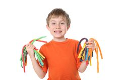 Boy holding colorful licorice candy. A young boy holds bunches of colorful licorice Stock Photography