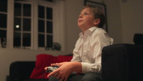 Boy Holding Controller Playing Video Game stock video