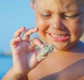Boy holding crab Royalty Free Stock Photos
