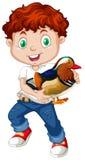 Boy holding a cute duck Stock Photo