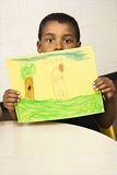 Boy Holding Drawing Royalty Free Stock Images