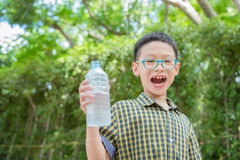 Boy holding drink water bottle Royalty Free Stock Images