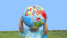Boy holding the earth model Royalty Free Stock Photo