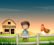 A boy holding an egg tray near the sleeping chicken Royalty Free Stock Photos