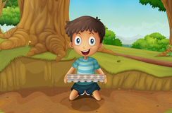 A boy holding an eggtray in the forest Royalty Free Stock Photos