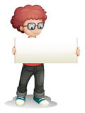 A boy holding an empty banner Royalty Free Stock Images