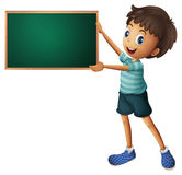 A boy holding an empty blackboard Stock Image