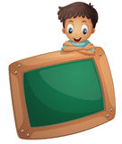 A boy holding an empty board Royalty Free Stock Photography