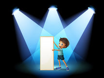 A boy holding an empty board with spotlights Stock Photos