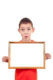 Boy holding empty frame Royalty Free Stock Image