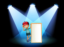 A boy holding an empty frame with spotlights Stock Images