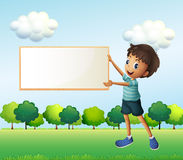 A boy holding an empty framed board Stock Photos
