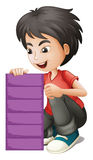 A boy holding an empty violet board Royalty Free Stock Image