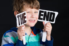 Boy Holding The End Sign Stock Images