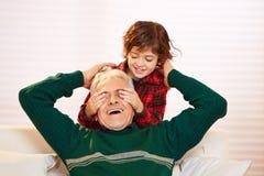 Boy holding eyes closed Royalty Free Stock Image