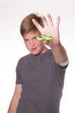 Boy holding fidget spinner. Young teenage boy holding fidget spinner in front of his face stock images