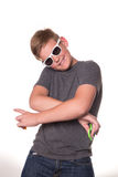Boy holding fidget spinner. Young teenage boy in sunglasses holding fidget spinners and crossing his arms Royalty Free Stock Image