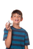 Boy holding fidget spinner. Younger boy holding fidget spinner in front of his face Stock Photography