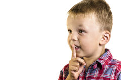 Boy holding a finger near lips Stock Photography