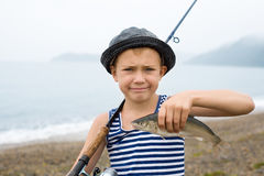 Boy holding a fish Stock Photo