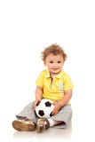Boy holding a footbal ball. Adorable boy holding a footbal ball, isolated Stock Images